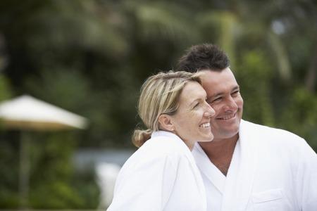 Couple wearing spa bathrobes