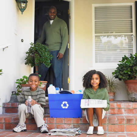 davenport: African American father smiling at children with recycling