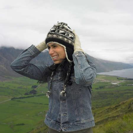 adventuresome: Hispanic woman wearing hat and gloves