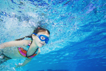 child swimsuit: Underwater shot of Asian girl swimming