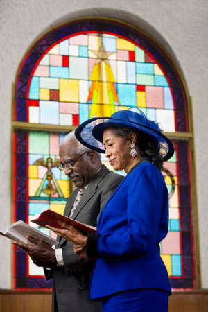 Senior African American couple in church LANG_EVOIMAGES