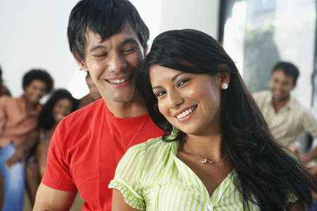 South American couple at party