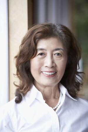 attired: Portrait of senior Asian woman