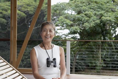 gramma: Senior Asian woman with binoculars