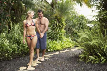 walking paths: Couple walking on tropical path