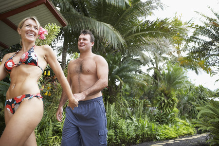 stepping: Couple walking on tropical path