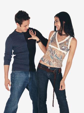 settee: Young Hispanic woman pushing man on chest
