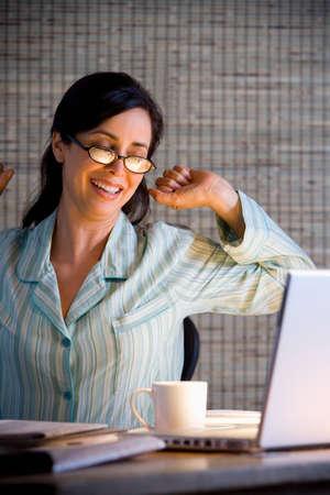 bathingsuit: Hispanic businesswoman working in pajamas