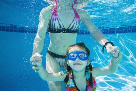 Underwater shot of Asian mother and daughter