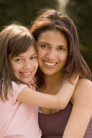 davenport: Hispanic mother and daughter hugging