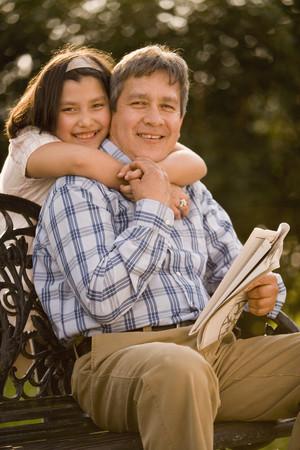 slumbering: Hispanic girl hugging father