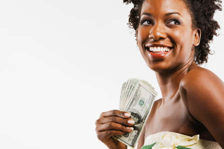 African American woman holding money Stock Photo