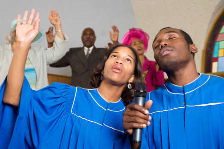 African American people singing in church Stock Photo