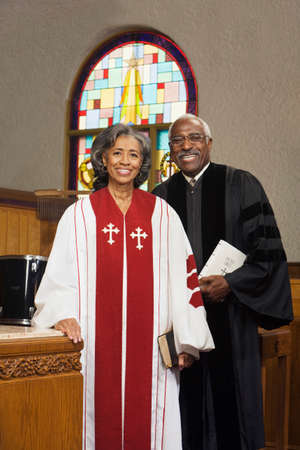 African American female and male Reverends in church