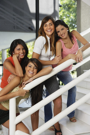 south western european descent: South American women on stairs LANG_EVOIMAGES