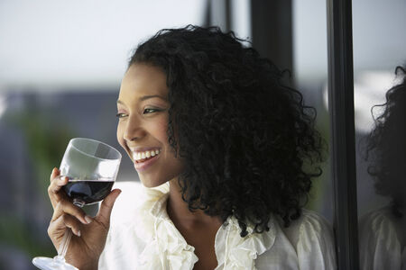 South American woman drinking wine Imagens