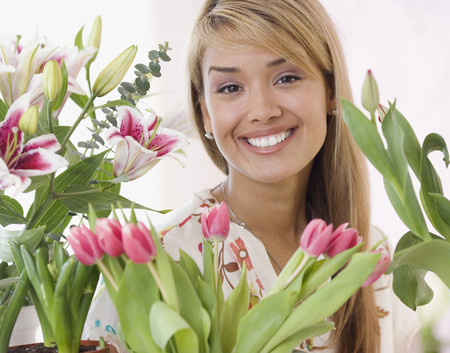 dubious: Hispanic woman surrounded by flowers