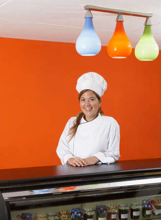 bakery products: Hispanic female baker in gourmet food store