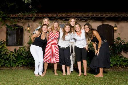 nite: Group of Hispanic women hugging