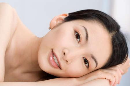 slumbering: Close up of Asian woman smiling