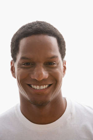 motioning: Close up of African American man smiling LANG_EVOIMAGES