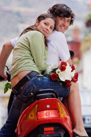 honeymooner: Hispanic couple on scooter