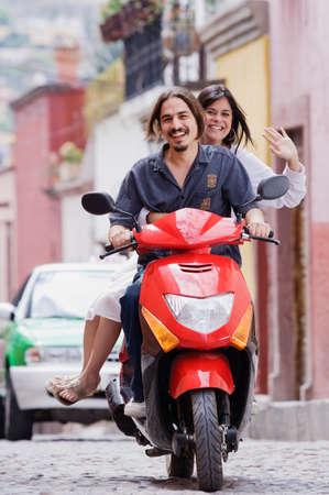 wooing: Hispanic couple on scooter