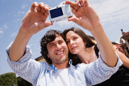bestowing: Hispanic couple taking own photograph