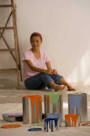 casualness: Asian woman with painting supplies LANG_EVOIMAGES