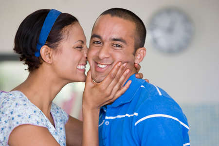 motioning: Young couple hugging