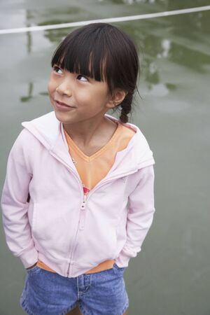 sopping: Asian girl with hands in pockets