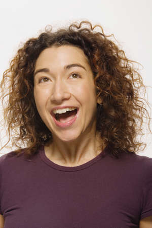 well beings: Mixed Race woman laughing LANG_EVOIMAGES