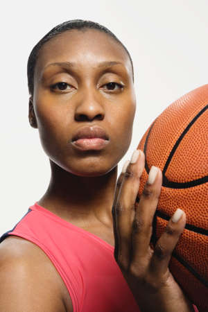 downcast: African American woman holding basketball