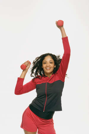 athletic gear: Indian woman lifting weights in athletic gear