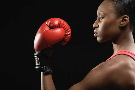 saturating: African American woman wearing boxing glove