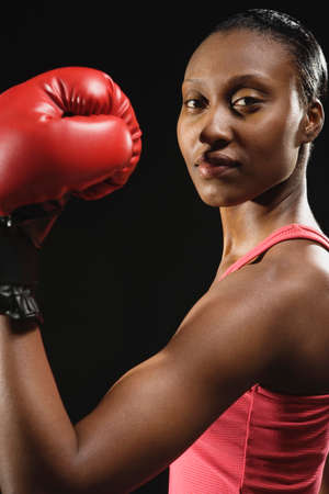 attired: African American woman wearing boxing glove