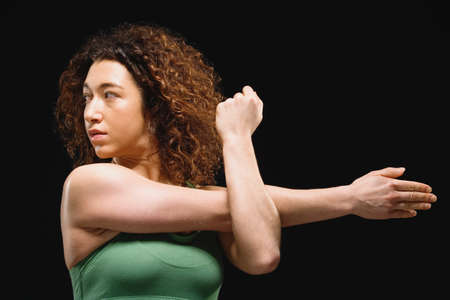 exerting: Mixed Race woman stretching