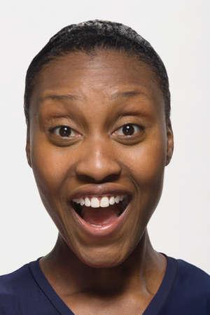 motioning: African American woman looking surprised