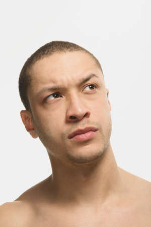 afro american nude: Mixed Race man looking skeptical LANG_EVOIMAGES
