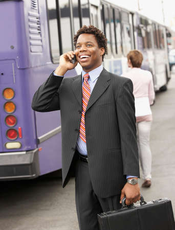 nite: African American businessman talking on cell phone
