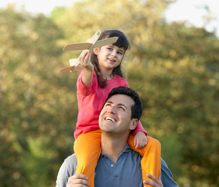enjoy space: Hispanic girl sitting on fathers shoulders LANG_EVOIMAGES