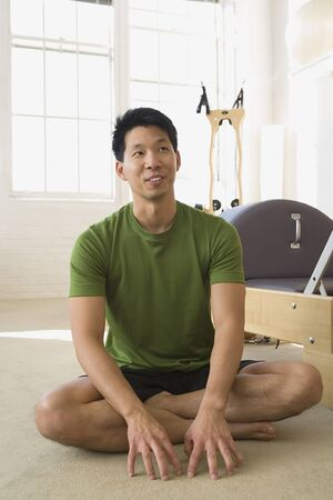 holistic view: Asian man sitting in exercise studio
