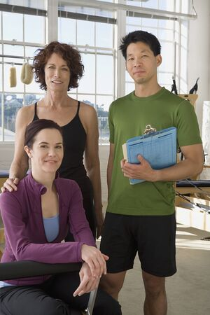 holistic view: Multi-ethnic business owners in exercise studio