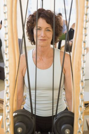 holistic view: Senior woman sitting in exercise equipment