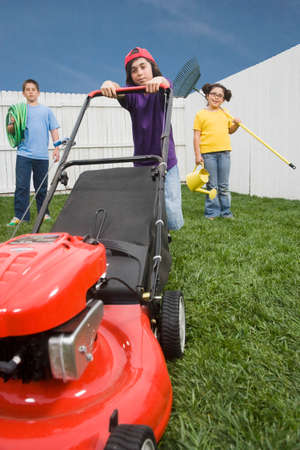 yard work: Multi-ethnic children doing yard work