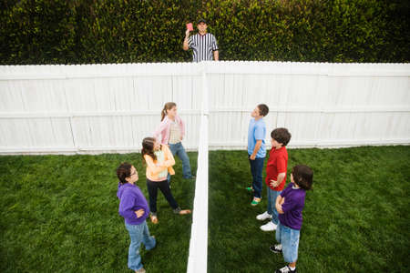 mixed race children: Mixed Race children on opposite sides of fence LANG_EVOIMAGES