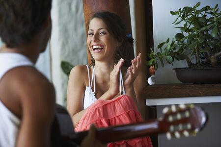 South American man playing guitar for girlfriend Banco de Imagens