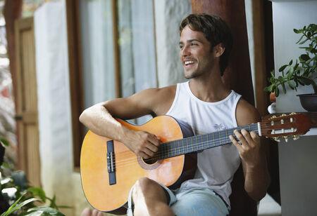 serenading: South American man playing guitar