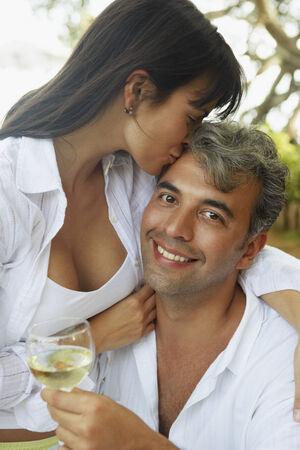 serenading: South American couple hugging