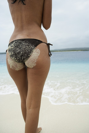 Rear view of South American woman at beach Imagens - 35735285